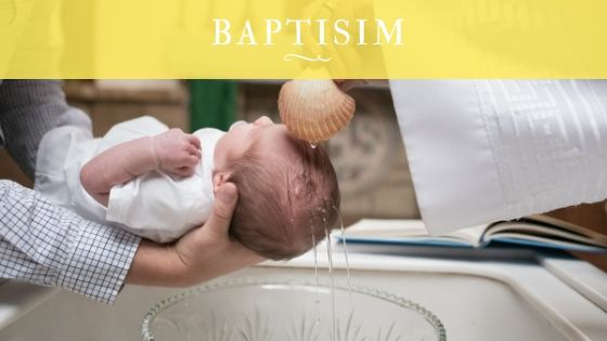 baby sprinkled with holy water for baptism